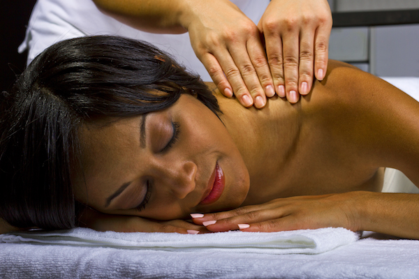 young African American female getting a massage in a spa